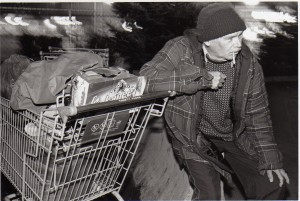 Image of a homeless man with his shopping cart